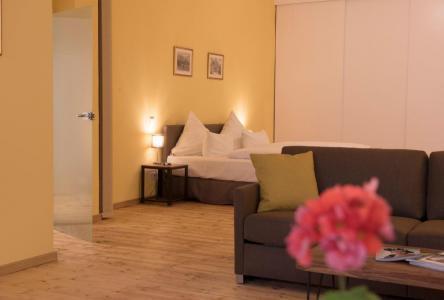 Sitz- und Schlafbereich im Loft Apartment